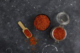 Saffron spice herb in wooden spoon